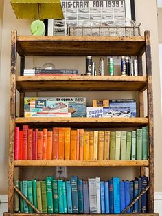 Add some whimsical flair to an old bookshelf by arranging your books in color order. Must do this.