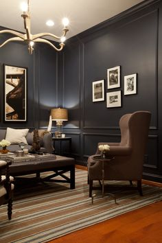 Stately elegance. Dark colors lend a dramatic air. Moulding and trim the same color as the wall creates a seamless look.