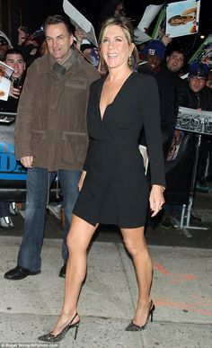 Jennifer Aniston showed off her shapely legs in a plunging and sophisticated little black dress as she arrived at The Daily Show With Jon Stewart in New York City on Thursday Jennifer Aniston Pictures, Jennifer Aniston Style, Jen And Justin, John Aniston, Justin Theroux, Jon Stewart, Dress And Heels, Lbd, Sexy Women