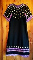 Elk tooth dress made by Michelle Lee in 2017 to wear at the Fond du Lac Veterans Pow wow in honor of a late friend.  Dress is made with imitation teeth, military surplus wool surge, size 11 beads and ribbon.  One ribbon was designed by a friend who is a native artist.  I have also made an underdress of cotton as the Pow wow will be in July.   Inspired by the work of the late Winona Yellowtail Plenty Hoops. .