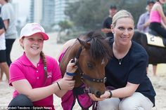 The royal gave a welcomed treat to a pony as she posed for a photo alongside a delighted young fan