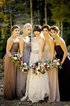 possibly my favorite color scheme. neutral-ish dresses, with one that's a bit darker/bolder, plus jewel toned flowers  Best of 2013: Mismatched Bridesmaid Dresses from Real Weddings