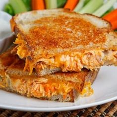 Chicken buffalo grilled cheese. Just picture. I tossed grilled diced chicken in generous amount of Franks Hot Sauce, added shredded cheddar to taste. Spread butter on the bread, added provolone slices and chicken mixture, other bread slice . Before flipping, butter other side of bread. Serve with Ranch. Delicious!