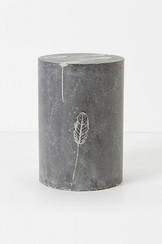 Fallen Leaves Cement Stool #anthropologie I've been investigating online how to make my own, but the framing part is very hard. I would definitely do this, only using other found object art for patterning.