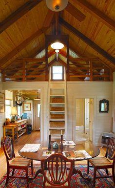 One room cabin. Storage behind ladder.