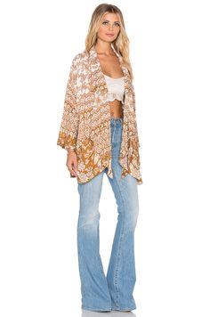 https://cdnc.lystit.com/photos/858e-2015/11/11/novella-royale-rust-hazely-mix-kimono-brown-product-2-504211983-normal.jpeg