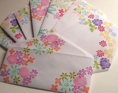 stamped envelope. Use markers to color the flowers on the rubber stamp different colors before staming onto envelope