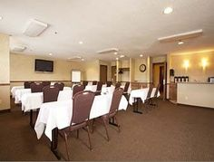 "Check out our sister property the ""Super 8."" Here's a quick pic of their executive board room that we cater our entire menu too! Call our sales office to book this space today: 989-772-4000"