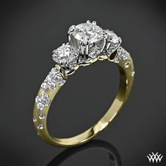 Beautifully unique, the 'Petite Champagne' 3 Stone Engagement Ring is sure to stop traffic! Beaming with 44 A CUT ABOVE® Hearts and Arrows Diamond Melee (0.25ctw; F/G VS). You can choose to purchase this ring as a setting only which will allow you to select all three diamonds or we can provide you with two