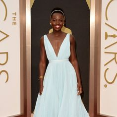 Such a gracious winner, in addition to sporting one of the best and most unabashedly feminine gowns for the evening: Celebrities on the Oscars Red Carpet 2014 | Pictures via PopSugar #Lupita_Nyong'o #Oscars_2014 #pastel_blue #Oscar_winning_gowns