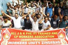 PHE daily wagers staging protest dharna in Jammu .  Excelsior/Rakesh