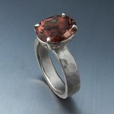 Sterling silver ring with prong set oval cut Oregon Sunstone.