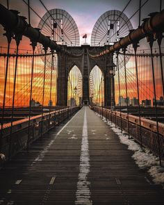 Flaming sky over the Brooklyn Bridge by Paul Seibert @pseibertphoto | via newyorkcityfeelings.com - The Best Photos and Videos of New York City including the Statue of Liberty Brooklyn Bridge Central Park Empire State Building Chrysler Building and other popular New York places and attractions.