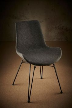 A testament to style and comfort at an affordable price, the Brooklyn chair is made from the highest quality materials and features a molded-wood seat base and solid steel frame and legs. SGS tested to level not only does the Brooklyn chair reflect ef Metal Chairs, Grey Fabric, Upholstered Chairs, Steel Frame, Eames, Contemporary Design, Brooklyn, Dining Chairs, Cushions
