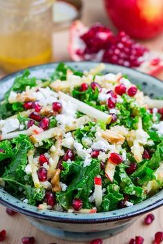 apple and pomegranate quinoa and kale salad w/ feta in a curried maple dijon dressing