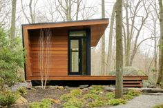 Studio Retreat, Chappaqua, NY, USA. This modern freestanding studio was created by replacing a  decaying 1960s structure with a space that allowed the client to co-exist with nature. Although the space is small, the windows that wrap the western facade frame the scenery and launch the inhabitant out into a void beyond that is considerably larger. Dark siding and decking, as well as the walnut interiors,  were chosen to relate the structure to its natural surroundings.
