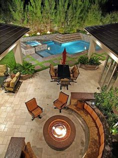 Fire Pit With Seating Near The Pool home outdoors pool backyard luxury exterior design fire pit home decorating Outdoor Rooms, Outdoor Gardens, Outdoor Living, Outdoor Patios, Outdoor Kitchens, Outside Living, Backyard Patio, Backyard Ideas, Nice Backyard