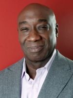 Michael Clarke Duncan was one    big, irresistible jumble of contradictions.   His presence was formidable, even intimidating: The former bodyguard had a    muscular, 6-foot-4 frame, but it was topped by the brightest of megawatt    smiles