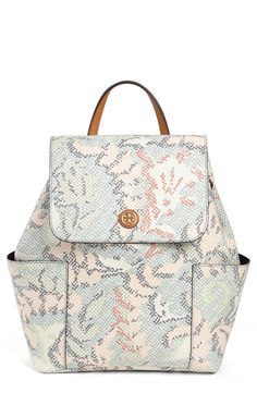 The pastel floral pattern adds eye-catching vintage sophistication to this darling Tory Burch backpack.