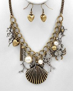 "CHUNKY SHELL AND CRAB BURNISHED GOLD TONE METAL NECKLACE SET WITH FAUX PEARL AND CRYSTAL ACCENTS      * If you need a necklace extender I have them for sale in my store.*          NECKLACE: 16"" L + EXT    DROP: 2 1/8"" LONG        HOOK EARRINGS: 1 3/8"" LONG           COLOR: GOLD TONE  $23.99"
