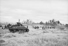 British Sherman tanks and infantry advance on Caen 9 July 1944 as part of Operation Goodwood