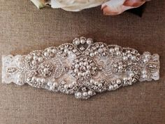 *Perfect for your special day!! *Main garter only *Garter set with toss garter can be found here.. https://www.etsy.com/listing/151365638/wedding-garter-bridal-garter-pearl-and?ref=shop_home_active **This gorgeous pearl and rhinestone crystal piece measures about 6 by 2.5 and is attached to an ivory lace garter. **PLEASE INCLUDE YOUR THIGH MEASUREMENT AT CHECKOUT. *This is made to order and comes attached to a Bella Fleur Boutique display card, great for gifts! *Please check out my sho...
