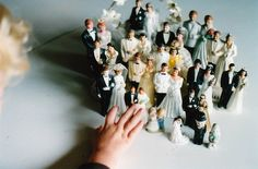 Plastic bride and groom cake ornaments
