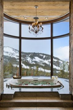 OMG snow... mountains... hot tub (chandelier in a bathroom though... not for me)