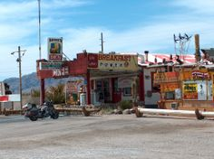 A truck stop on route 66. This has to do with chapter 15, when it describes one of these truck stops, and the people who stop at them. The Joads will probably stop at some of these truck stops on their way to California. -DR