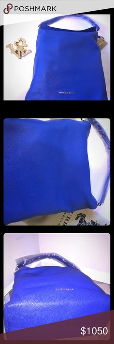 """**NWT!!**😍😍Burberry London grainy leather hobo!! Burberry London blue textured leather medium hobo bag with a soft sculpted silhouette!! 😍😘😘 This is such an elegant, yet understated bag for every woman. Has hidden magnetic enclosures to secure the top. It is accompanied with Burberry dust bag!! Size: Medium, style: Shoulder bag. Product dimensions: 15.5""""H 13.8""""W 5.1""""D. Not looking for trade.. Happy shopping!!!👀 Burberry Bags Hobos"""