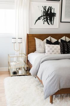Beautiful bed. Tie in black pillows with dresser