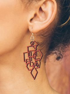 These statement earrings are all about the bold color and strong geometric shapes. Made from sustainable laser-cut wood, these super lightweight earrings are perfect for all-day wear. - Made In U.S.A