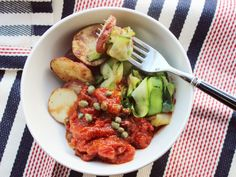 What's black, green and red all over? Your lunch tomorrow. Swap out pasta for sweet, shaved zucchini and crispy roasted potatoes to go with this bold, briny sauce.