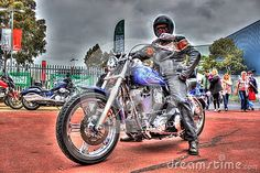 Classic American blue Harley Davidson motorcycle with rider at Moto Expo a bike show held in Melbourne, Australia