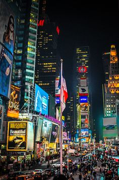 Times Square, New York City. This is the gleaming shopping Mecca that dreams are made of. Click pin through to post for info on shopping in NYC. Photo by MK Feeney.