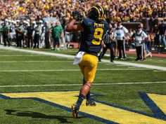 Michigan's Grant Perry catches the ball to score a touchdown against Hawaii during the home opener game at Michigan Stadium in Ann Arbor, Michigan, on Saturday, September 3, 2016.