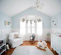 Soft Blue Pallette. Love the split walls. Our favorite white upholstered glider from Taylor Scott.
