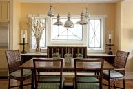 Using variations of one item in a like color creates interest, but keeps a unified feeling. Just take a look at the chairs and pendant lamps in this sunny dining room. Table: homeowners' own; Woven chairs: Baker, LA; Wood chairs: custom, Erinn V Maison, Sherman Oaks; Pendant lights: Jamie Young; Candlesticks: Baker, LA; Glass vase: Pottery Barn.