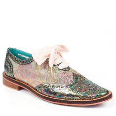 Functional but fanciful, these unique brogue style flats feature oil slick embossed leather with pink and gold lace panels providing a feminine twist.