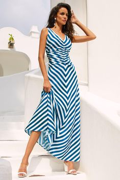 Flattering stripes create a stylish look on this sleeveless, v neck maxi dress, cut in a soft, lightweight woven fabric with slimming ruched details. Top off with statement a