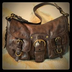 """Awesome Coach Legacy flap shoulder bag. EUC! Beautiful Coach bag! Deep bronze tone color is subtly metallic, with antiqued hardware. Plum satin lining. Very minimal signs of wear! Great size with 2 front pockets, outside back snap pocket, inside zipper pocket, two inside slip pockets, Key ring, and lots of brass buckle detailing. This is a very high-end Coach bag from the Coach retail store, not an outlet bag. 13""""x9""""x3 1/2"""". Strap drop 10 1/2"""". Coach Bags Shoulder Bags"""