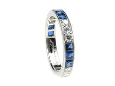 Platinum Calibre Sapphire Diamond eternity ring. Sapphire Weight 2.8ct Diamond weight 0.69ct, available in all finger sizes please contact Lucie Campbell  http://www.luciecampbell.com/diamond-wedding-bands/1081----2/  £4400  richard@luciecampbell.com  Lucie Campbell Jewellers Bond Street London  http://www.luciecampbell.com