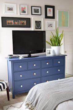 Artwork around tv. Bedroom idea