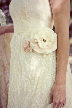 Large handmade flower on the white dress