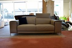 Contrasting grey leathers give this Italiqn sofa an added sense of depth