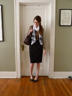 black pencil skirt, tan sweater...white and grey floral scarf