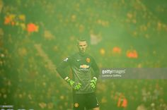 David De Gea of Manchester United looks on through smoke from a flare during the FA Cup Fifth...