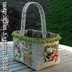 Love this basket with its pretty ribbonwork flowers!