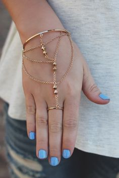 Our Boho Bliss Hand Chain is a must for all of your dainty detail needs! It is a…