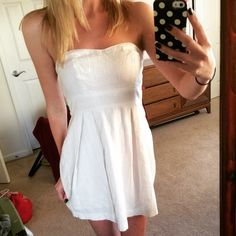 White Strapless Dress White strapless dress. Zips up in the back. Love this dress because so many outfits can be made with it. Pairs well with a cute cardigan, tights, and even wears well with boots. Pre loved but still in pristine condition Forever 21 Dresses Strapless